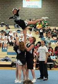 by: Contributed Photo, The first-ever competitive cheer squad performs a stunt at an Estacada basketball team earlier this month before its three competitions. The team consists of Bobby Moore, Jessaca Sutherland, Brianna Court and Brittanie Molzan.