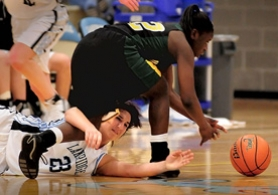 by: Vern Uyetake, Kayla Glanville hustles for a loose ball with the Lions' Rosetta Adzasu.