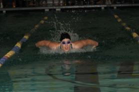 by: Vern Uyetake, Lakeridge's Lydia Burris swims to victory in the 100 butterfly. She also won the 50 freestyle.