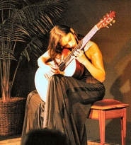 by: David F. Ashton, Although young, Ana Vidovic plays classical guitar with a master musician's touch.