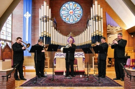 by: David F. Ashton, Members of the Columbia Brass play a fanfare, as they begin the second half of their program at Woodstock's All Saints' Church.