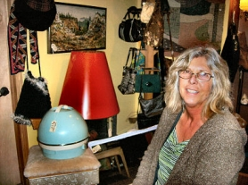 "by: Rita A. Leonard, Victoria Lloyd, owner of Westmoreland's new ""Sputnik Variety"" store, offers a collection of vintage ""Clothing, Furniture and Oddities"" to a wide range of customers."