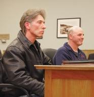 by: Darryl Swan, (Front) Terry Morgan, 44, and John Harper Jr., 45, listen to the Scappoose City Council vote on a business license appeal for a skate shop on Columbia River Highway. The shop was initially denied because of a decade-old conviction against Harper for third-degree rape of a minor.