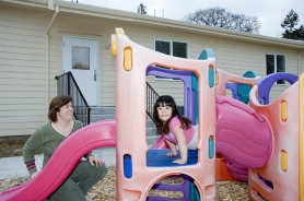 by: Rick Swart, Deborah Christensen Liao and her daughter, Marissa, check out some of the new playground equipment at Grace Lutheran church in Scappoose. The church is putting the final touches on a new building it plans to use for a Christian-based daycare center and preschool.