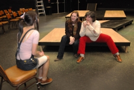 by: Vern Uyetake, West Linn High School senior Rosie Dickson practices her role as a jailers daughter in Shakespeare's The Two Noble Kinsmen, a Jacobean comedy, first published in 1634. Jessica Middleton Murray, left, and Annie Kaiser look on at the after-school performance.