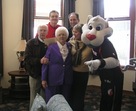 by: Courtesy Photo, Amy Slatta and her daughter, Luanne Rugebregt, with (from left) Bill Schonley, Dale Schlueter, Bob Gross and the Blazer mascot.