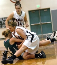 by: DAN BROOD, PLAYOFF BATTLE — Tualatin sophomore Julie Arndorfer battles Sheldon's Tami Brown for the ball as Tualatin sophomore Meaghan Cichoke (14) runs over.