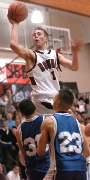 by: DAN BROOD, UP HIGH — Sherwood senior Travis Lutes goes up high to the basket in the Bowmen's win over Woodburn.