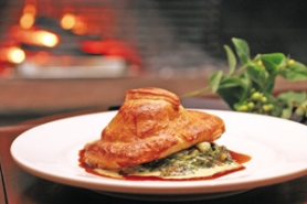 by: KATIE HARTLEY, Venison Wellington is one of the most popular main dishes at Meriwether's, but lighter eaters can choose from among a nice selection of salads and intriguing starters.