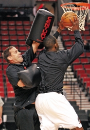 by: ©2008 CRAIG MITCHELLDYER, Blazer assistant coach Bill Bayno, wearing arm pads, defends forward Martell Webster in pregame warm-ups Tuesday at the Rose Garden.
