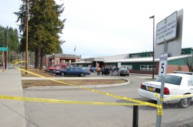 by: Darryl Swan, A police tape keeps onlookers at a safe distance from Vernonia schools following a small explosion outside the school cafeteria Thursday.
