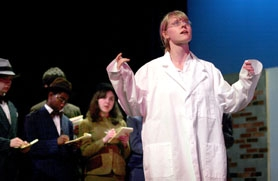 "by: Jaime Valdez, MAD SCIENCE — Tualatin High senior Hillary White plays the part of Dr. Sigelius in the school's production of Karel Capek's ""The White Plague."""