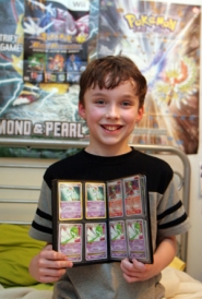 by: KATIE HARTLEY, Olliver Barr, 11, is an ace Pokémon player with his eye on the world championships. He's collected more than 1,000 Pokémon cards and decorates his room with Pokémon posters as well as the ribbons and medals he's won in competitions.