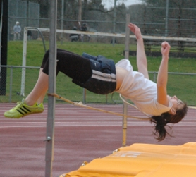 by: John Brewington, High jumper Candace Loyd will be one of the team leaders for the Lady Lions this spring. Loyd took seventh in state last year in the high jump. She had a little hair tangle problem during practice here.