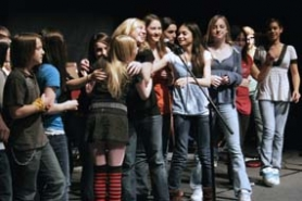 "by: Shanda Tice, Sherwood Middle School drama students hug after performing the play ""Higher Ground"" Sunday at the Portland Center for the Performing Arts."