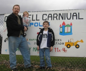 by: Ellen Spitaleri, Jeff Louden, chief organizer for the Hector Campbell Elementary School carnival,  is hoping the event  on March 15 will attract  lots of families. Louden, above, holds daughter Kathryn, and at right is son, Cole.