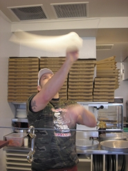 by: Ellen Spitaleri,  Joshua Welch, right, twirls pizza dough high in the air at Flying Pie Pizzeria on McLoughlin Boulevard, near Les Schwab.