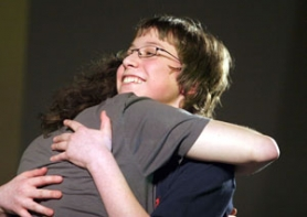 by: Katie Hartley, Trevor Fonvergne, 13, of Damascus Middle School hugs the runner-up after winning the 2008 Portland Tribune/