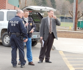 by: Darryl Swan, Scappoose Police Chief Doug Greisen (center) manages the scene of an explosion in Vernonia on Thursday, March 6. Vernonia School District Superintendent Kenneth Cox is seen at right on the cellular phone. Canine units swept the school buildings and grounds following the 