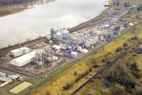 by: Submitted, This aerial photo of the Cascade Grain Products corn ethanol plant at Port Westward taken in January shows a plant in its final stages of completion. Fifty-three people have been hired to operate the $200 million plant, which will be fed by Midwest-grown corn delivered via rail. Charles Carlson, the company president, said corn deliveries into the Pacific Northwest from cornbelt states are not new, and that the region is a jumping off place for corn exports to the Pacific Rim.