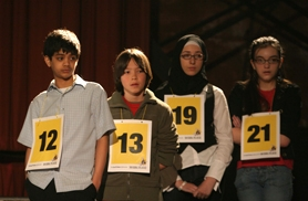by: Karie Hartley, Timo Kirchler of Forest Grove (second from left) made it to the fourth round of a regional spelling bee March 8.