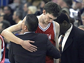 by: JONATHAN HOUSE, TOUGH LOSS — Westview senior Andy Poling is consoled by Wildcat assistant coaches after his team's 73-57 loss on Saturday at Grant High School.