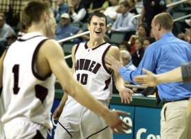 by: JAIME VALDEZ, WINNING SMILE — Sherwood senior Kole Krieger (10) and the rest of the Bowmen celebrate their 52-44 win over Mountain View in Wednesday's Class 5A state tournament quarterfinal contest.