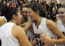 by: ©2008 MATTHEW GINN, Left: Senior Iris Lerch (middle) celebrates with teammates after Lincoln's March 1 win over Reynolds, which put the Cardinals in the state tournament.