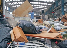 by: KATIE HARTLEY, Greg Matsuda, who is in the process of remodeling his home, brings his building scraps and old appliances to Metro's Central Station sorting facility.