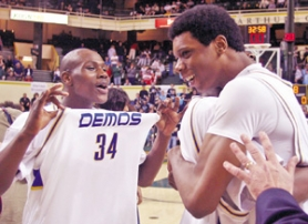 by: KATIE HARTLEY, Demos Derail Nelson (left) and Terrance Jones celebrate their state title. Sophomore Jones made the all-tournament second team.