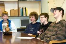 by: John Klicker, From left, Corbett High School freshmen David Schroth, 15, Finn Thorsell, 14, Daniel Handy, 15, and Cole Ceciliani, 15, talk about their recent placing at the the sixth annual Academic WorldQuest at Lewis & Clark College on Feb. 23. The team is headed to the national competition in Washington, D.C., Saturday, April 5.