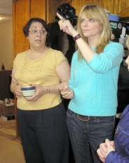 by: Ellen Spitaleri, Cheryl Tiegs, right, shows Barbara Rosier where she can make improvements in her kitchen ceiling, by removing panels and adding a different light fixture.