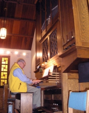 by: Ellen Spitaleri, Bill Crane practices on the 25-year-old organ at St. John the Evangelist Episcopal Church in Milwaukie.