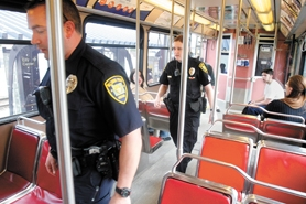 by: Jonathan House, Hillsboro Police Officers Dave Bergstrom and Stacey Jepson patrol a MAX train at the Willow Creek/185th Avenue station March 12. The officers are part of a westside precinct patrol that will increase security on MAX trains in the westernmost part of Washington County.