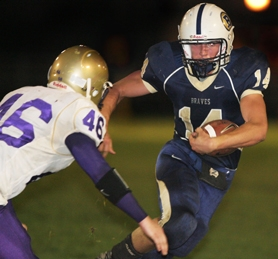 by: Tommy Whitcomb, Banks senior Brad Markham carries the ball during the Braves' Oct. 11 game against Astoria. Healthy for the first time all season, Markham rushed seven times for 33 yards.