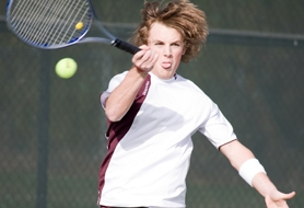 by: Chase Allgood, Forest Grove junior Brett Baumgartner smacks a forehand during last Tuesday's season-opening match against Dallas.