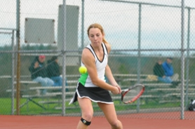 by: Vern Uyetake, Danika Tonning returns a shot during her win over Lakeridge on Tuesday. Tonning won the consolation bracket at state last year and returns as West Linn's No. 1 singles player this season.