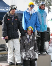 by: submitted photo, WINNERS — The Tigard snowboarding team of (from left) Adrian Roberts, Erik Nelson, Ian O'Gorman and Scott Bankhead took first in Sunday's meet.