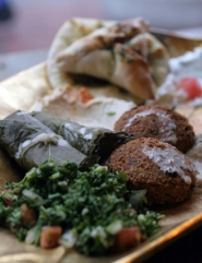 by: KATIE HARTLEY, Tabbouleh, baba ghanouj and other Middle Eastern treats fill the meze platters while warm greetings fill the dining room at Habibi.