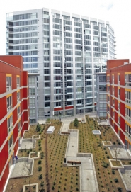 by: TRIBUNE PHOTOS, The taller Civic has condos for sale, but at the Morrison (foreground, with courtyard), rents are very low for formerly homeless tenants and slightly subsidized for working-class people who don't make much money.
