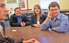 by: JIM CLARK, For their public-health class at Benson High, Thath Kim (from left), Albert Le, Justine Grandbois and Anatoliy Vlasenko surveyed local ethnic-minority churches and identified reasons church members may not have gotten flu shots.