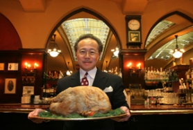 by: JIM CLARK, Roast turkey at Huber's is a tradition dating back to the 1800s and owner Jim Louie's great-uncle and namesake.