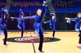 by: John Klicker, Hillary Dube, front and center, gives it her all at the OSAA Dance and Drill State Championship, along with teammates, from left, Erica Heine, Shelley Dietz, Jolene Rice and Adriana Chepiga on Saturday, March 15. The team placed second in the 6A Large division.