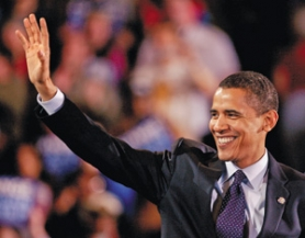 by: L.E. BASKOW, Presidential hopeful Barack Obama waves to supporters at a packed Memorial Coliseum.