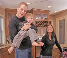 by:  JIM CLARK, Blazer Joel Przybilla and wife Noelle show off son Anthony, 2, in their Tualatin home. After bouncing around some in the NBA, the center and his family are happy he is now a fixture with the Blazers.