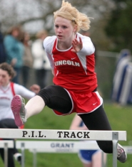 by: KATIE HARTLEY, Cardinal junior Megan Macoubray won the 100-meter high hurdles Thursday in 16.47 seconds.