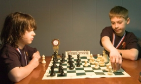 by: John Klicker, Sean Richardson, left, and Tucker Price, both students at Franciscan Montessori Earth School in Portland, show off their chess skills a few days after competing in the Chess for Success tournament March 21-22 at the Oregon Convention Center.
