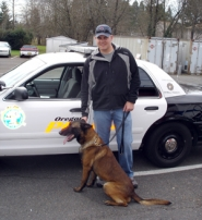 by: courtesy of the Oregon City Police Department, Oregon City Police Officer Shaun Davis with Jagger, the department's new Belgian Malinois.