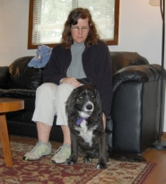 by: Anthony Roberts, Mary Bradford and her dog, Rambo, at home a few days after the shooting.