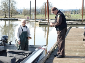 by: Lona Pierce, Columbia County Sheriff's Deputy Larry Weaver checks Billy Fisher's boating